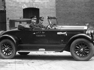 Deputy Chief Duncan McLean in City of Toronto automobile 1927-1940