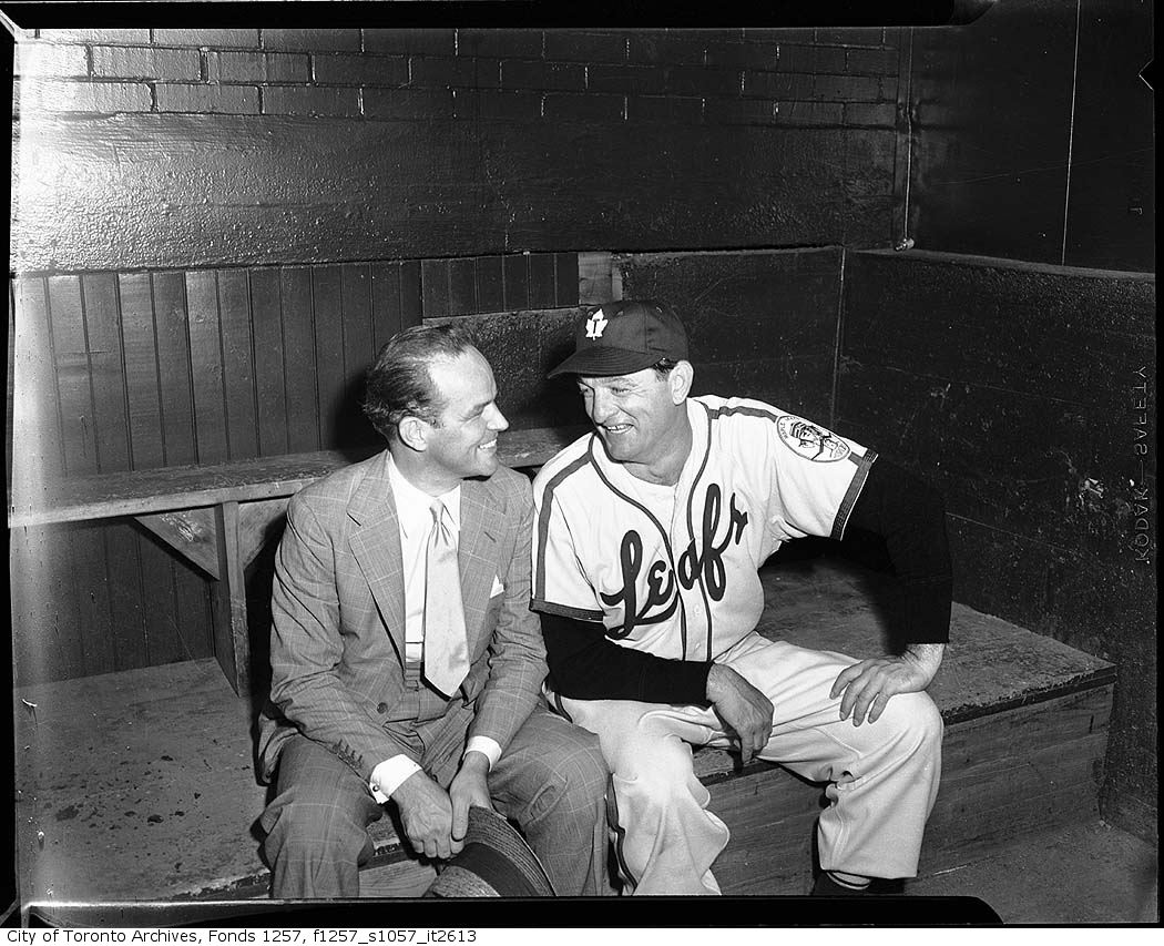 Jack Kent Cooke with baseball player in Toronto Maple Leafs Baseball Club dugout, Maple Leaf Stadium 195?