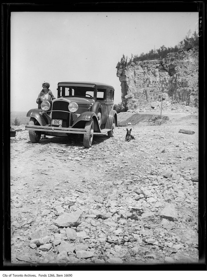 Milton (?), rock bluff and car, Marjorie Laing. - May 26, 1929