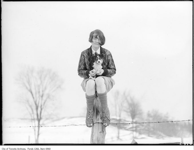 Ski-ing, girl with dog seated on post. - January 17, 1926 - Vintage Animal Photographs