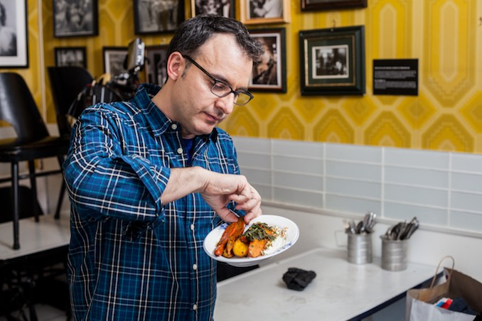 John Catucci trying a roasted heirloom carrots dish for You Gotta Eat Here