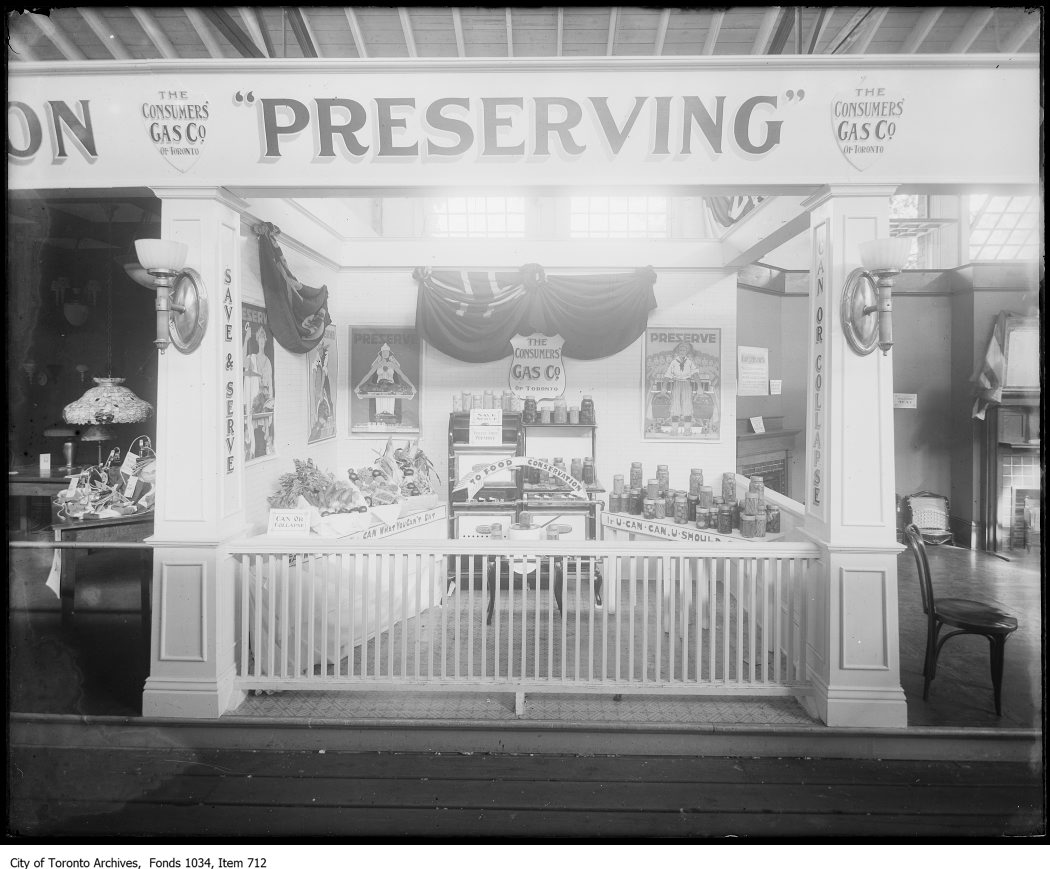 "1918 - C.N.E. exhibit of food preservation using ring-top glass preserving jars ""Can What You Can't Eat"" and ""If U Can U Should Can"""