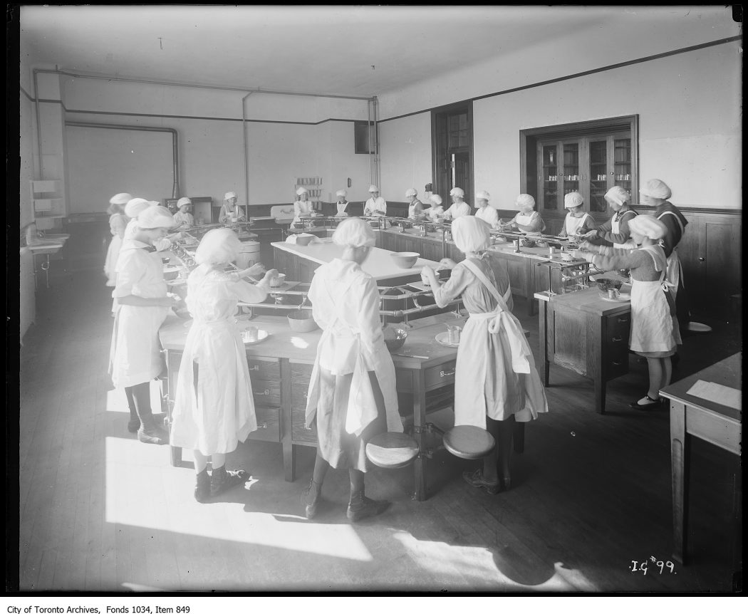 1923 - Domestic Science class at Earl Grey School - students using specially designed gas burners to learn cooking skills