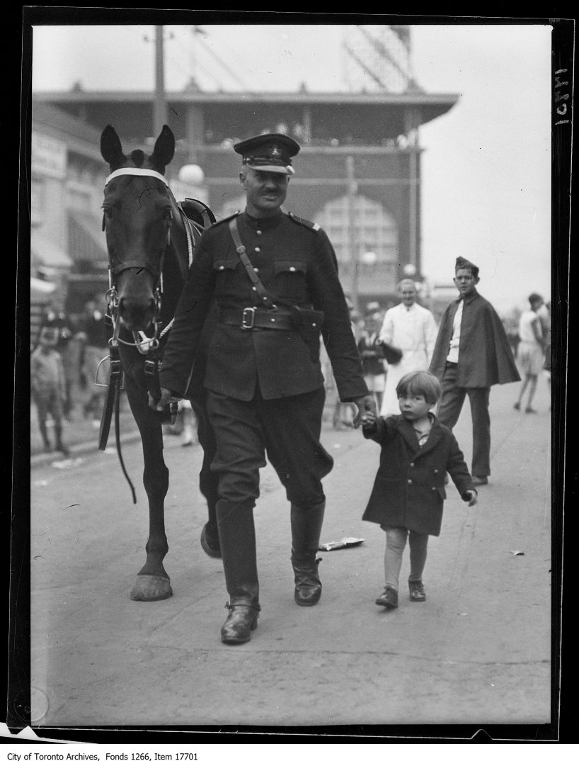 1929 - CNE, Kids Day, mounted officer with lost kid