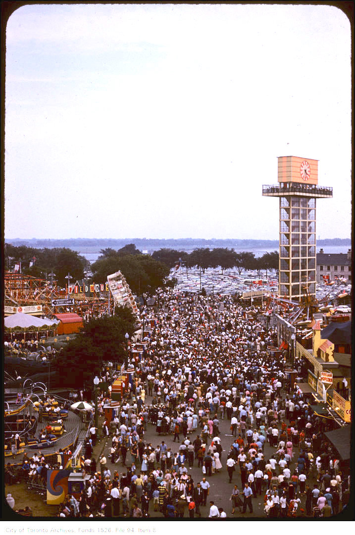 1958 - Slight overhead view of crowds on CNE grounds and new Shell oil tower