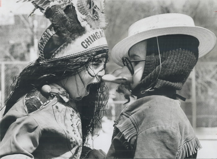 1967-tammy-fisher-6-dressed-in-indian-costume-looks-as-if-hes-going-to-take-a-bite-out-of-the-nose-of-peter-perkins-5-who-is-dressed-as-christopher-columbus