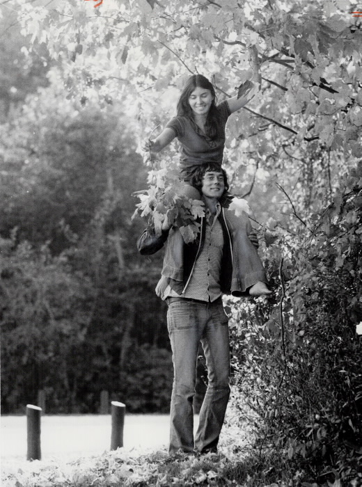1973 - Collecting autumn leaves in Morningside Park, 21-year-old Beth Lamb rides on the shoulders of Robert Kalisz, also 21 - Vintage Autumn Photographs