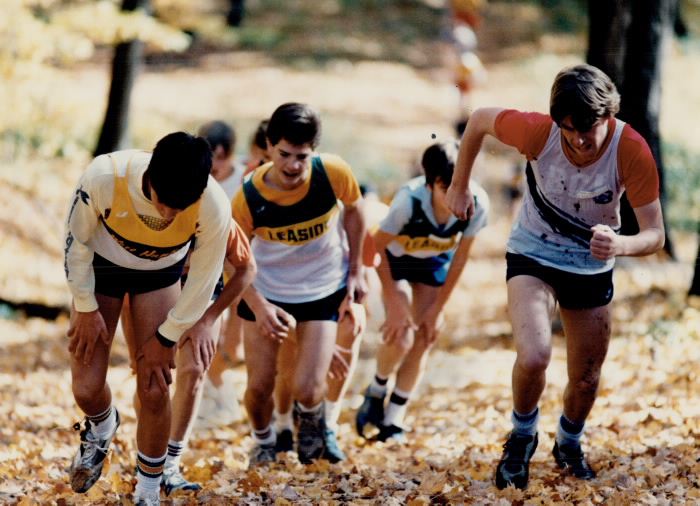 1985 - Athletes get a hard lesson in running; A near perfect autumn day couldn't help ease the pain for these runners as they neared the to of a hill at Earl Bales Park