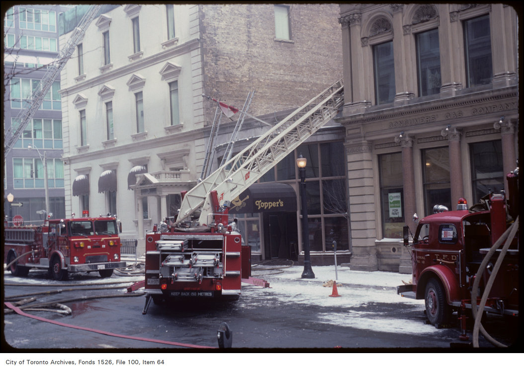 1982 - View of fire truck and ladder at Adelaide Street East and Toronto Street