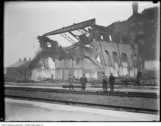 1907 - Men viewing the demolition of fire remains at site of future Union Station.