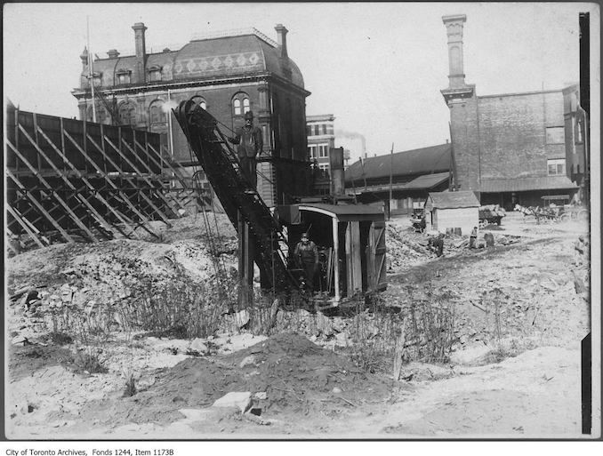 1908 - Excavating in the Great Fire ruins for new Customs House, Front Street and Yonge Street.