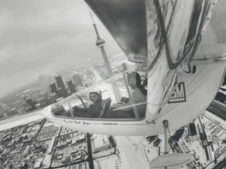 1985 - A wing-mounted camera captures this view of the Toronto skyline with pilot Larry Newman 37 left and Star photographer Mike Slaughter
