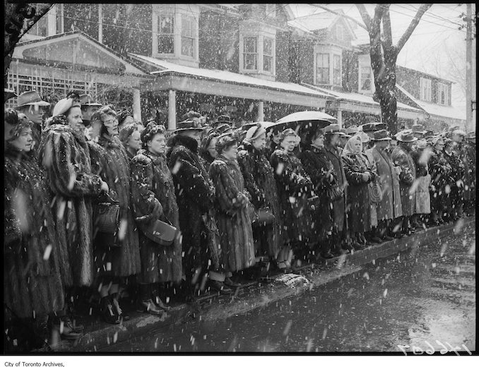 Detective Sergeant Tong funeral, people waiting in snow storm - 1952