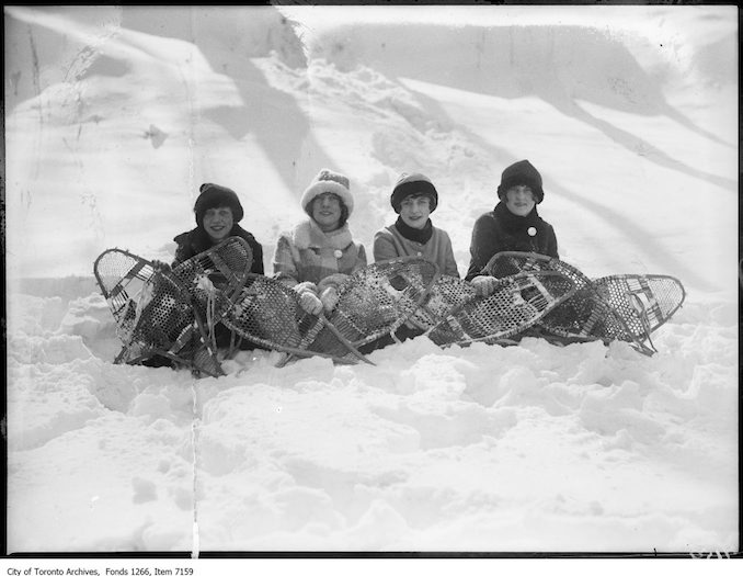 High Park, snowshoes, seated in snow, backlight. - February 19, 1926