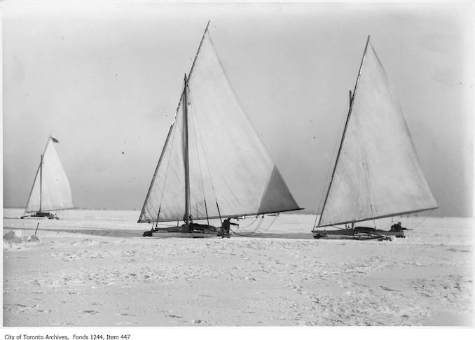 Toronto Winter Photographs Iceboats, Toronto Bay. - [between 1906 and 1910] - photograph of three iceboats racing a car (not shown) on frozen Toronto Bay.