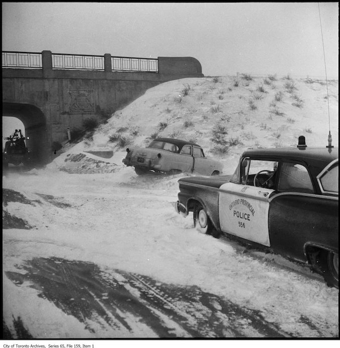 OPP cars in the snow. - 1960 - photographs of OPP (Ontario Provincial Police) cars in the snow.