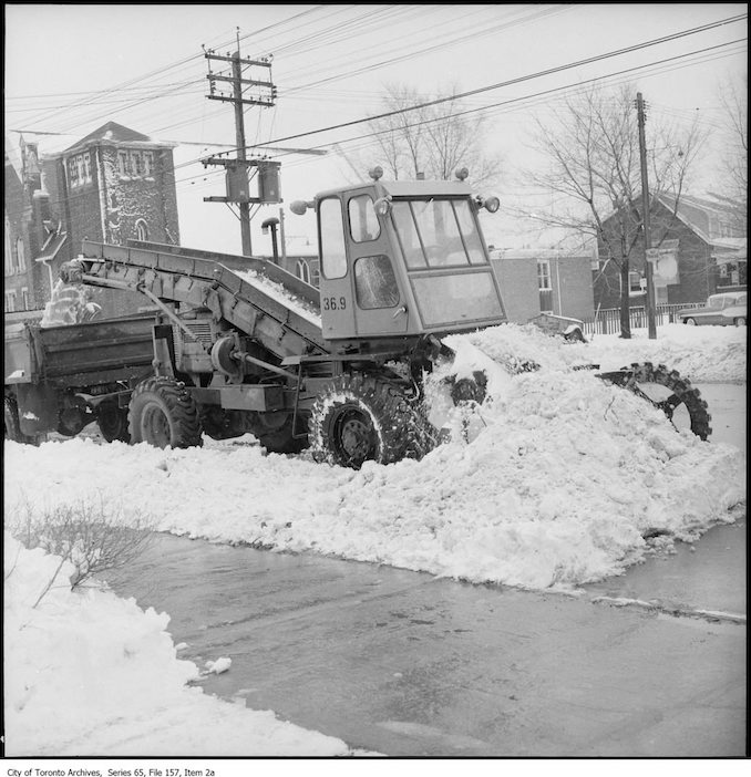 Snow removal equipment and workers. - 1960