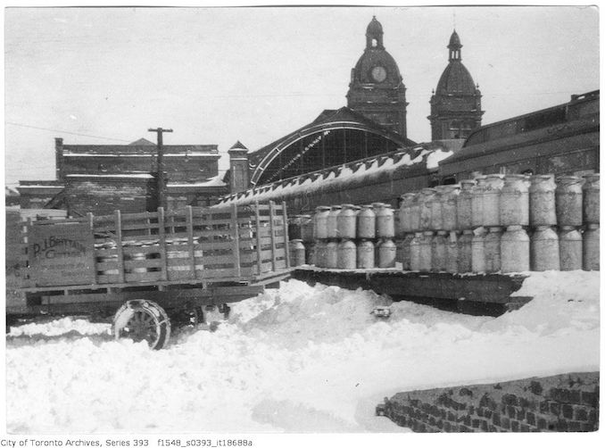 Union Station milk cans in snow - 1924