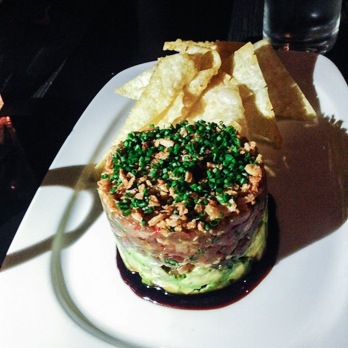 "tuna tartare complete with lashings of avocado, crispy shallots, sweet soy and ""wontons"""
