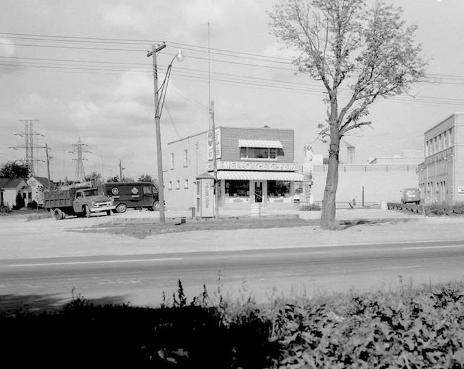 File consists of 22 photographs of the widening of a section of Dundas Street West, between Kipling Avenue and Paulart Drive. Intersections documented include those with Paulart Drive, Wilmar Road, Poplar Avenue and Acorn Avenue. A number of service stations appear in the photographs include McCleary's Esso Service, and Shell, White Rose, Texaco and Sunoco stations. Included is a photograph of 6 Points Plaza, consisting of a Loblaw's, Zellers, Reitmans, and other small shops.