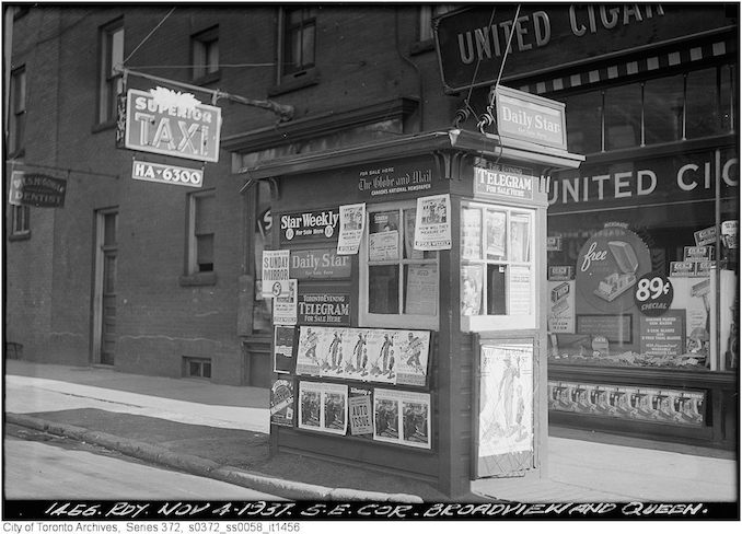 Although the photographer indicated that this image shows the southeast corner of Broadview Ave. and Queen St. E., it is actually the northeast corner that is shown. The photograph shows a news vendor's kiosk covered with ads for the Daily Star, the Globe and Mail, the Telegram, and the Star Weekly. Behind the kiosk is the shop window of a United Cigar Store, and a sign for Superior Taxi. - nov 4th 1937