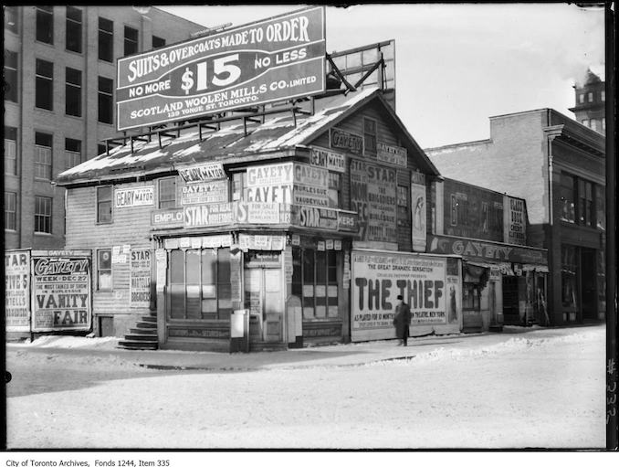Store plastered with signs, northwest corner of Adelaide Street West and Bay Street. - [ca. 1910]