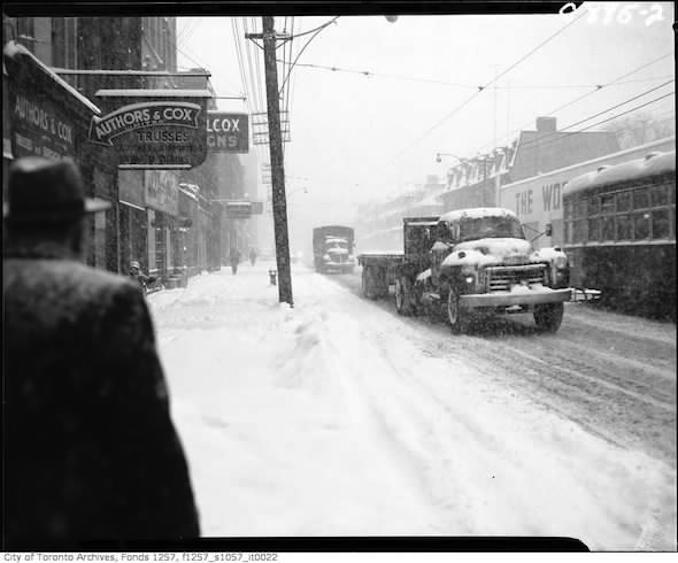 Item 22 – King Street West and John Street during snow storm.– 26 January 1961