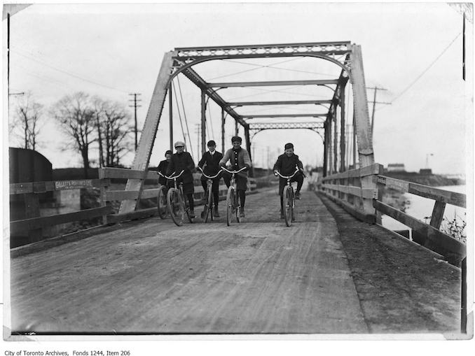 Boys cycling across Lakeshore Road bridge at Mimico. - [1907?] - Vintage Bicycle Photographs