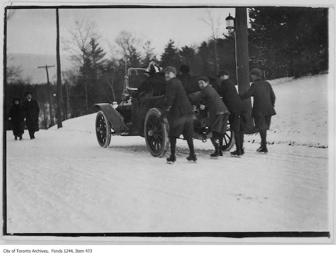 Boys in skates being pulled by car, High Park. - 1908