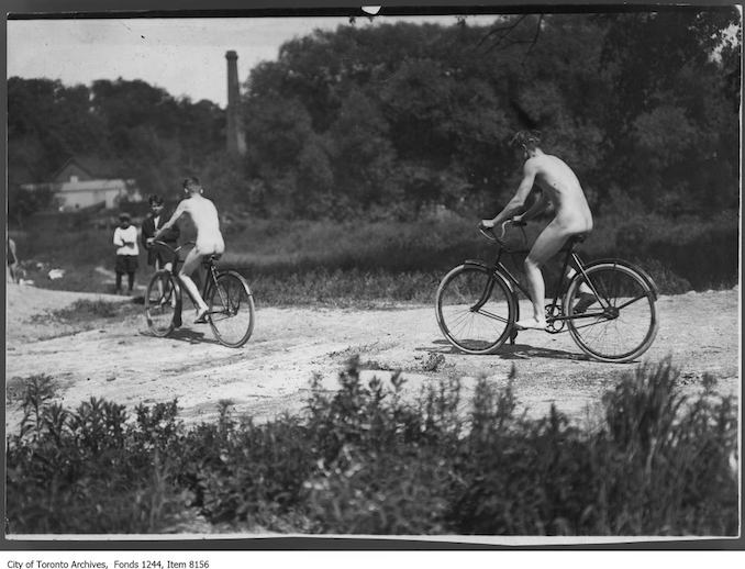 Cycling beside Don River, between Don Mills Road and Leaside . - [ca. 1912] - Vintage Bicycle Photographs