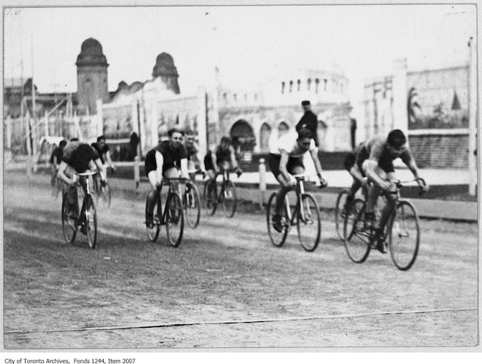 Finish of bicycle race, CNE. - September 2, 1926. The winner of the one mile race was Bill Elder, right. - Vintage Bicycle Photographs