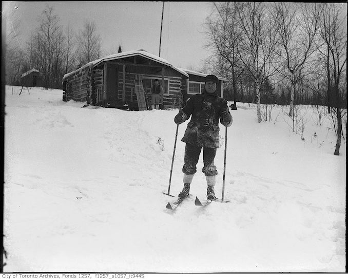 Lou Turofsky skiing near cabin in woods - 193-? - vintage skiing photographs