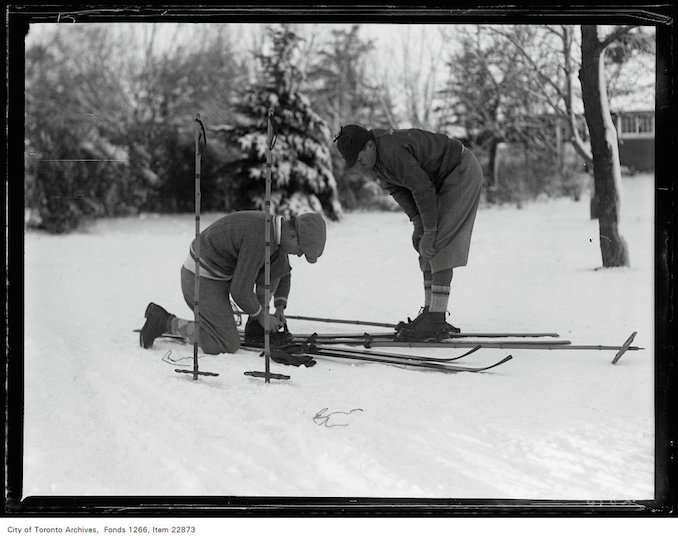 Rosedale Golf [Course], skiers adjusting straps January 7, 1931 - vintage skiing photographs