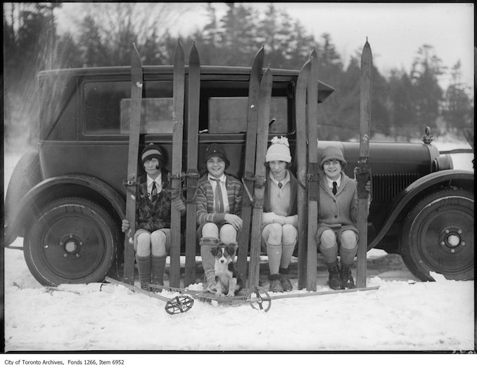 Ski-ing, four girls on running board of car. - January 17, 1926 - vintage skiing photographs