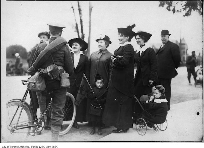 Soldier with family. - [1914?]. A note says that the location is the city limits of Hamilton, where soldiers on a trek were met by their families. (However, the soldier shown has a bicycle.) - Vintage Bicycle Photographs