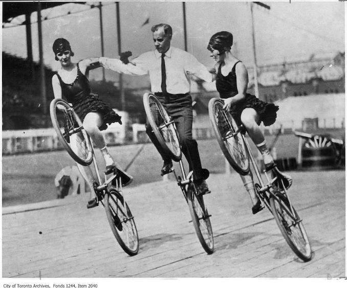Trick cyclists at CNE Grandstand. - [ca. 1920] - Vintage Bicycle Photographs