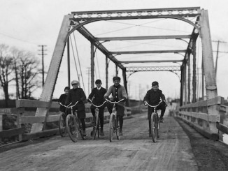 Boys cycling across Lakeshore Road bridge at Mimico. - [1907?]