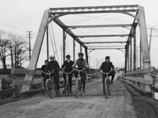 Boys cycling across Lakeshore Road bridge at Mimico. - [1907?]