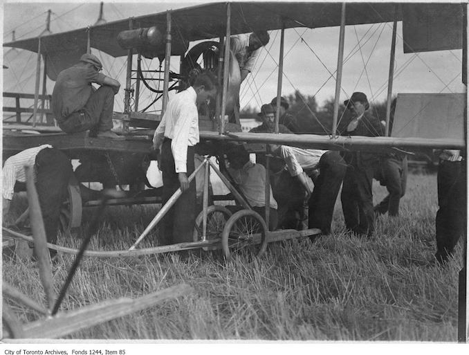 J.A.D. McCurdy's bi-plane with 7-cylinder Gnome rotary engine, and that the event is probably either the Aviation Meet held at Donlands Farm, Todmorden Mills, August 3-5, 1911, or the Aviation Meet, Hamilton, July 27-29, 1911 - Vintage Airplane Photographs