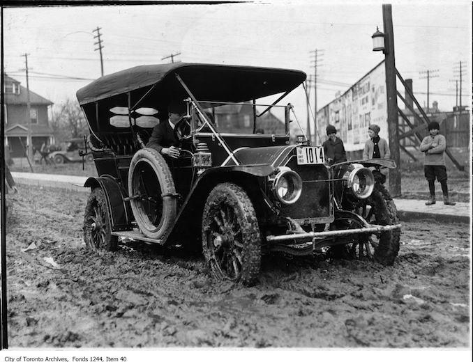 Automobile on muddy Morley Avenue. - 1912