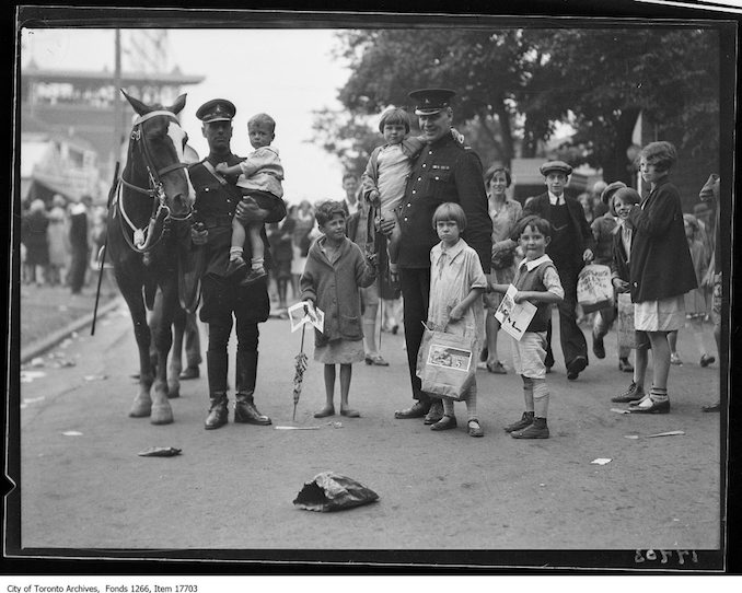 CNE, Kids Day, mounted officer and foot constable with lost kids. - August 27, 1929