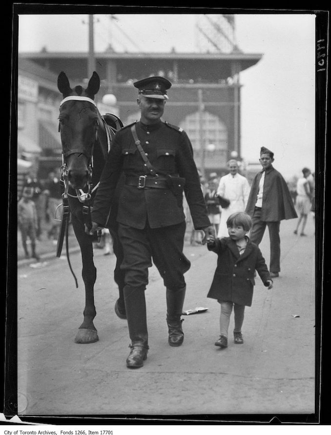CNE, Kids Day, mounted officer with lost kid. - August 27, 1929