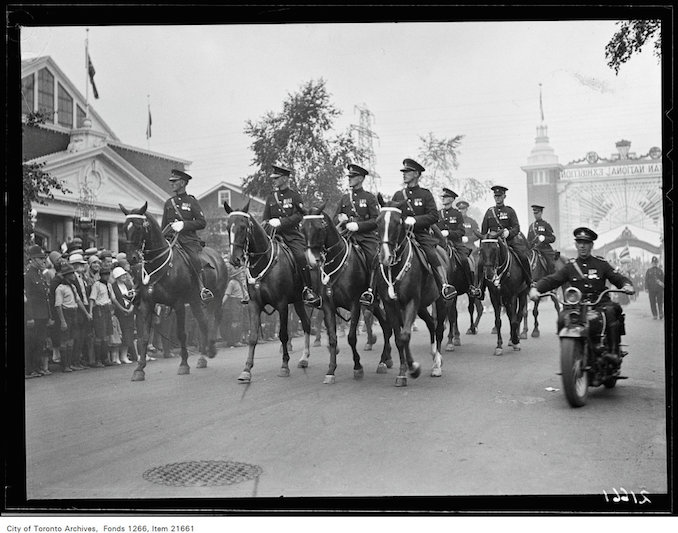 CNE, luncheon group, Warriors' Parade, mounted police. August 23, 1930