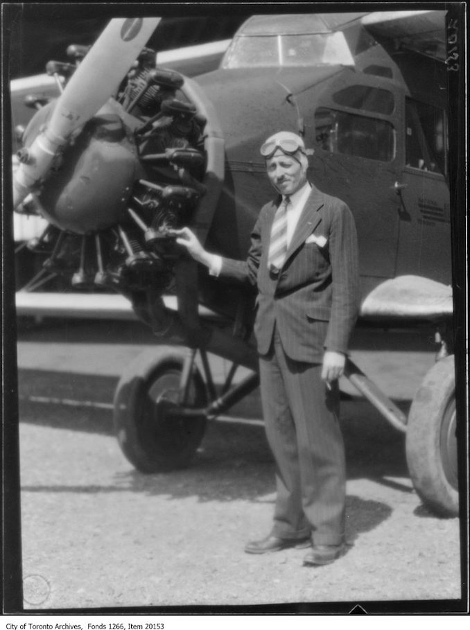 Captain Earl Hand in front of plane, close. - May 8, 1930