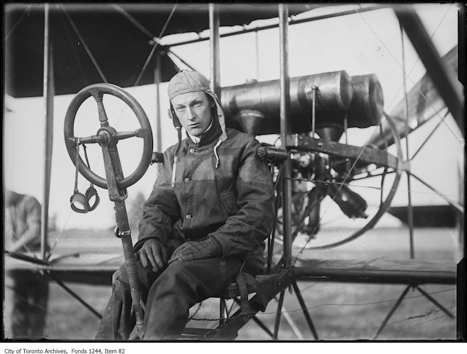 Charles F. Willard sitting in plane. - [1910?]