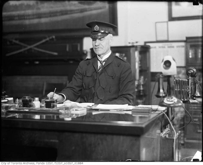 Chief Constable Samuel Dickson at desk in station