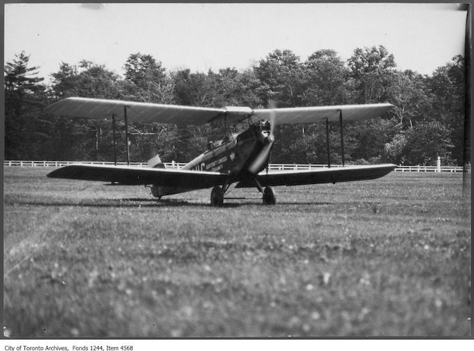 Cirrus Moth airplane . - 1929 - photograph. A note says it was the first plane to arrive at Thorncliffe Racetrack for the TFC meet.