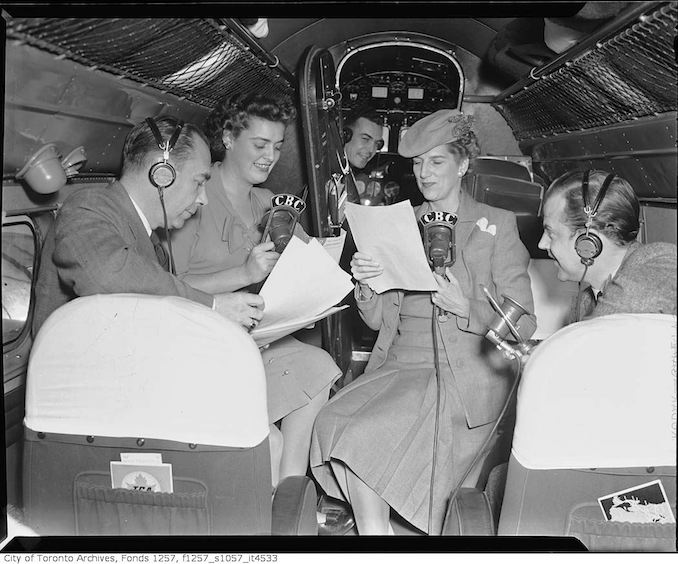 Clare Wallace and group broadcasting from inside Trans-Canada Airlines airplane