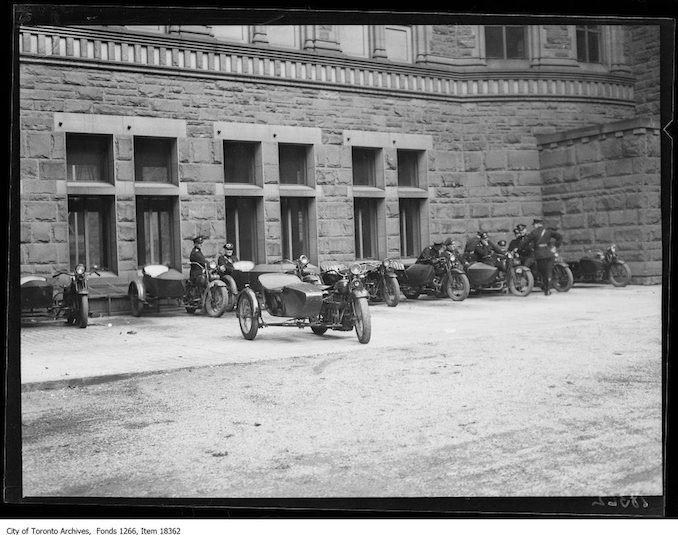 Communist meeting, motorcycle officers watching. - October 12, 1929