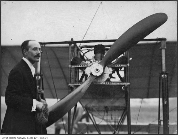 Count Jacques de Lesseps with plane . - 1910 - photograph of a man standing in front of an airplane. Information provided by a researcher indicates that the airplane is probably a Bleriot IX mono-plane with 3-cylinder Anzani engine, named Scarabee, and that the event is probably the Ontario Motor League Aviation Meet held at Trethewey Model Farm, Weston, July 8-16, 1910.